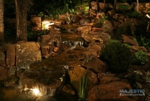 landscape lighting on water fall